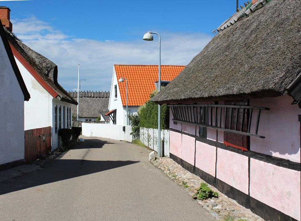Idyllic houses along the narrow street in the old quarter of Gilleleje
