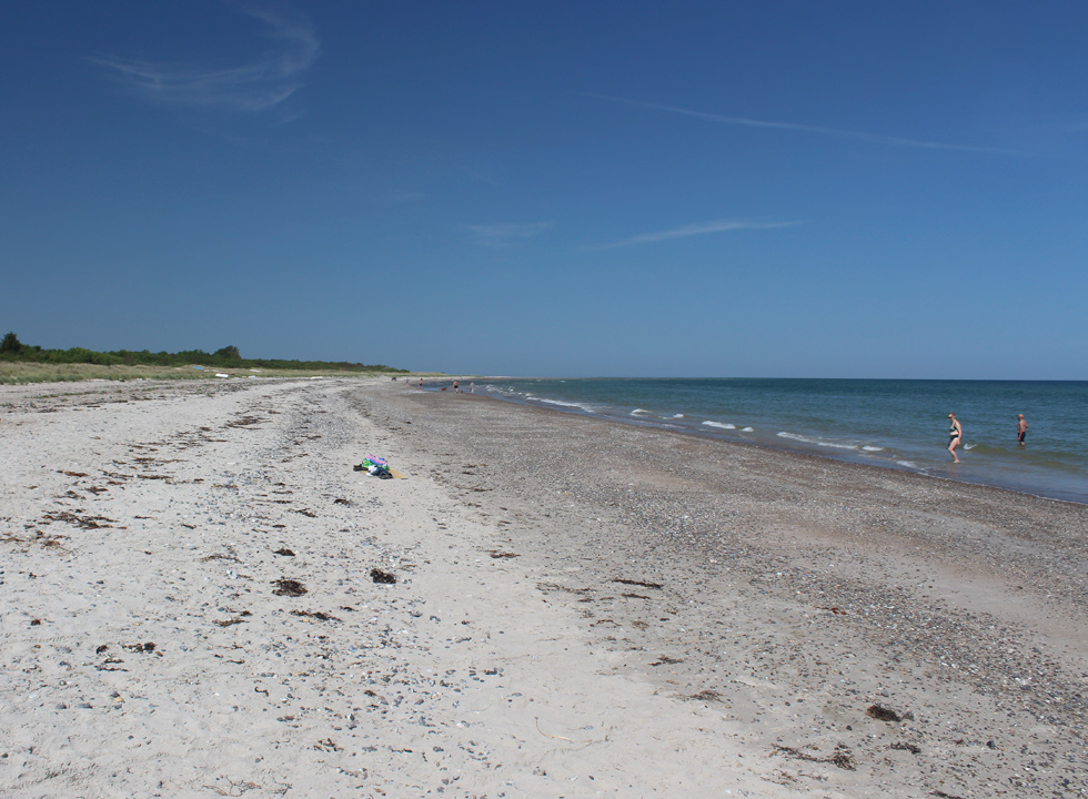 Lovely, wide and sandy beach with small dunes in the holiday area Gjerrild