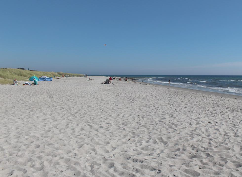 Wide sandy beach with dunes and inviting bathing water in Grenå Strand