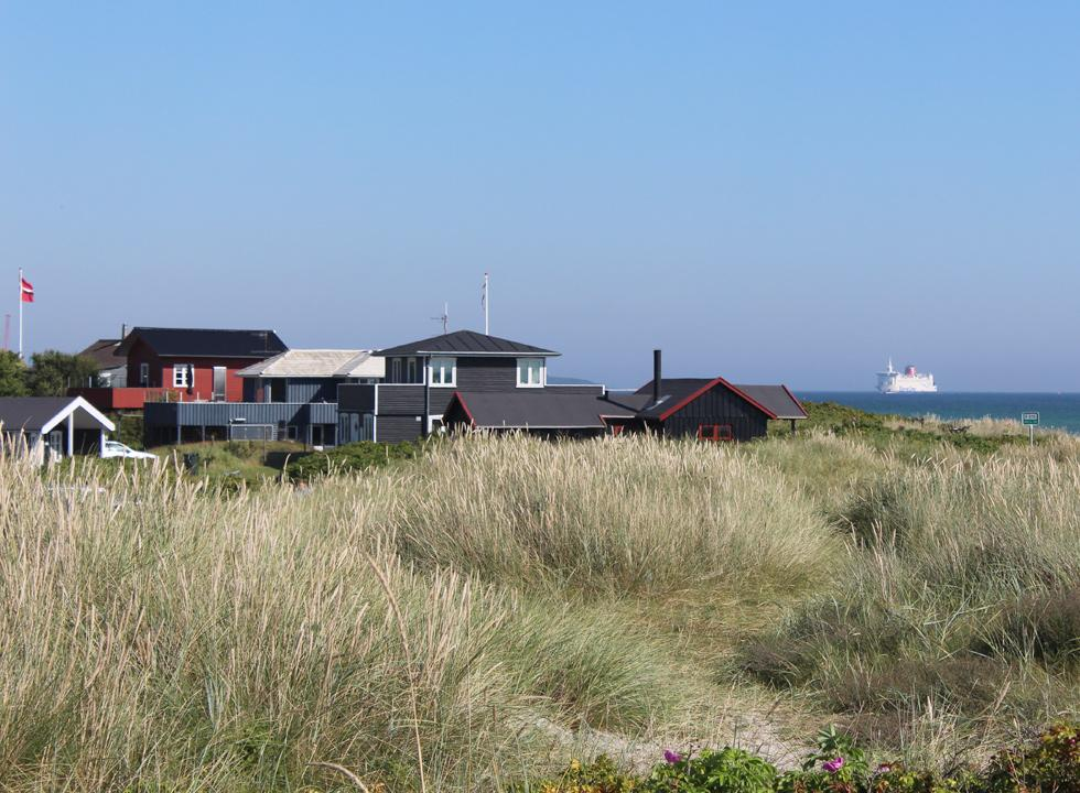 View of the holiday homes, the Kattegat and a large ferry from the dunes in Grenå Strand