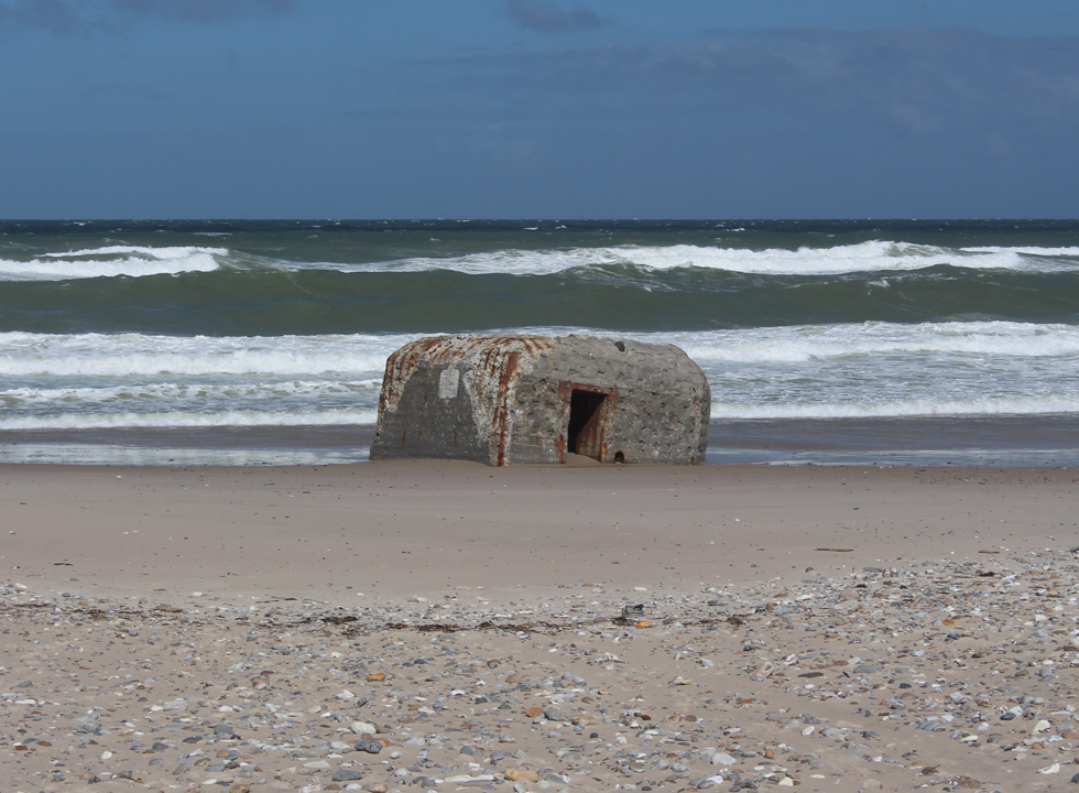 Bunker in the water's edge on the beach of Harboør