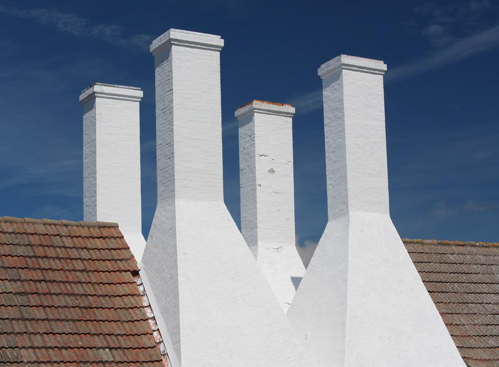 The characteristic smokehouse chimneys at Hasle Røgeri