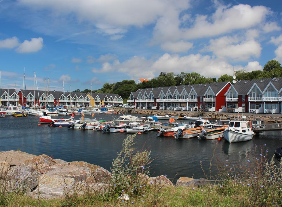 The cosy harbour houses in Hasle are surrounded by the marina with dinghies and pleasure boats