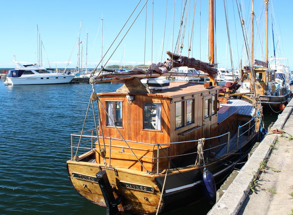Beautiful and well-maintained wooden ships in the cosy marina in Havnsø