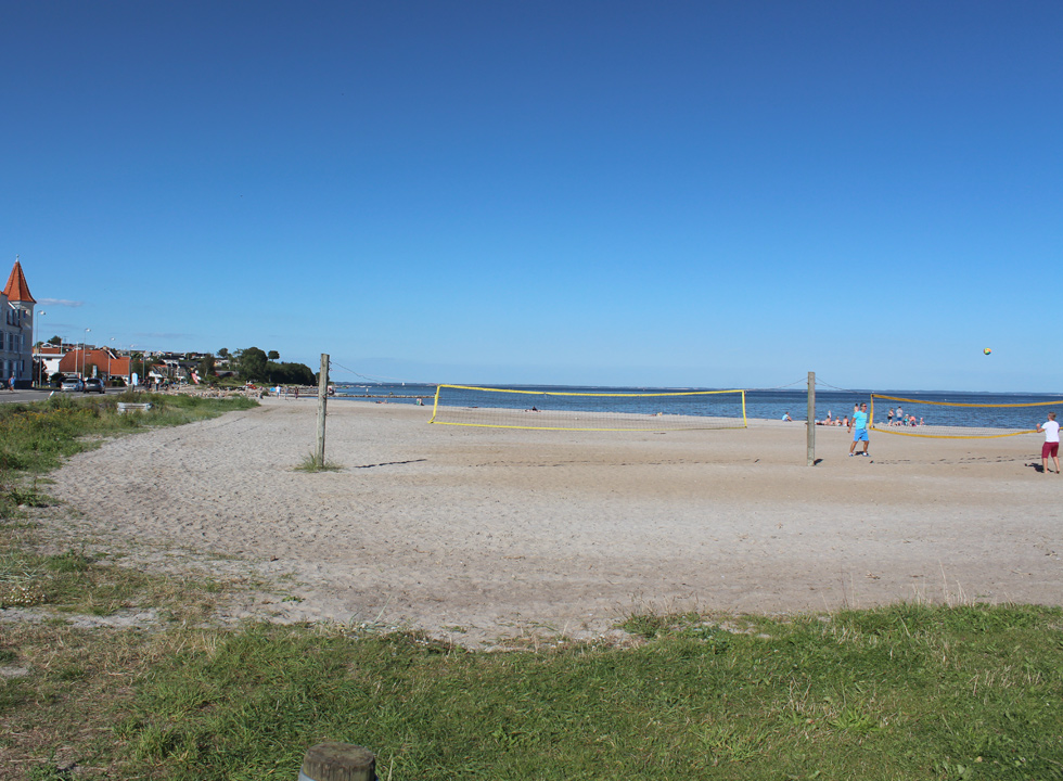 View along the wide sandy beach in the holiday town Hejlsminde