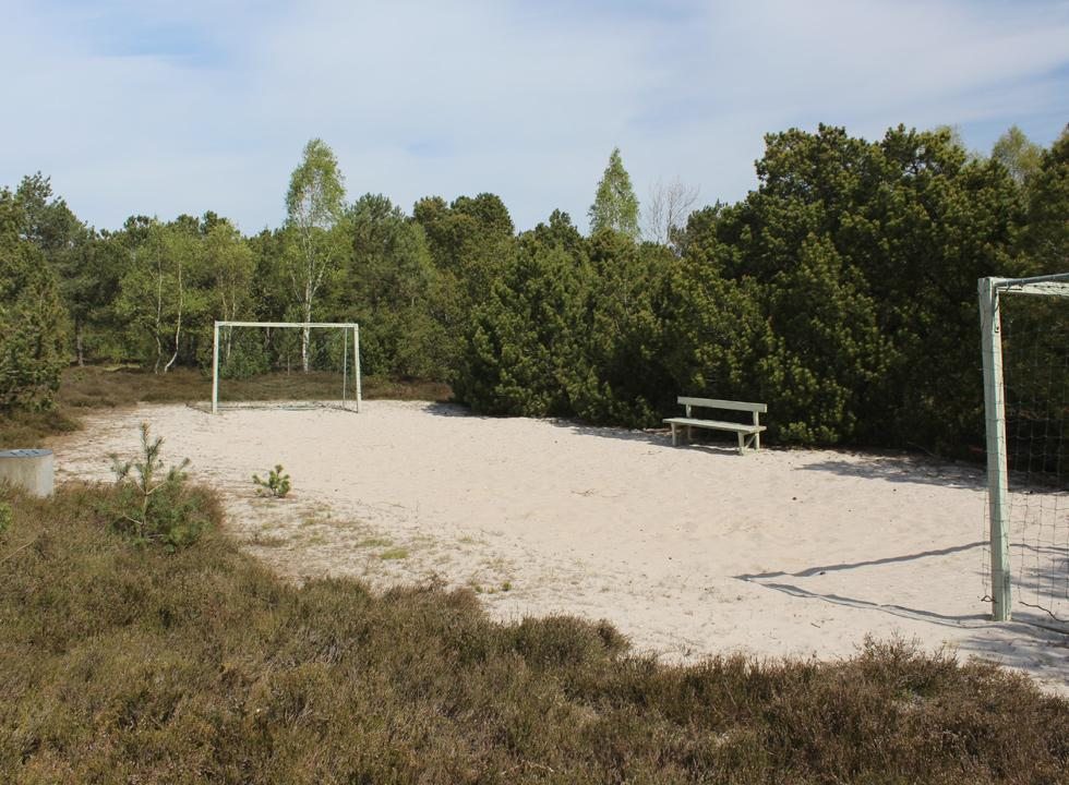Sandy course with goals by the forest playground between the holiday homes in Helberskov