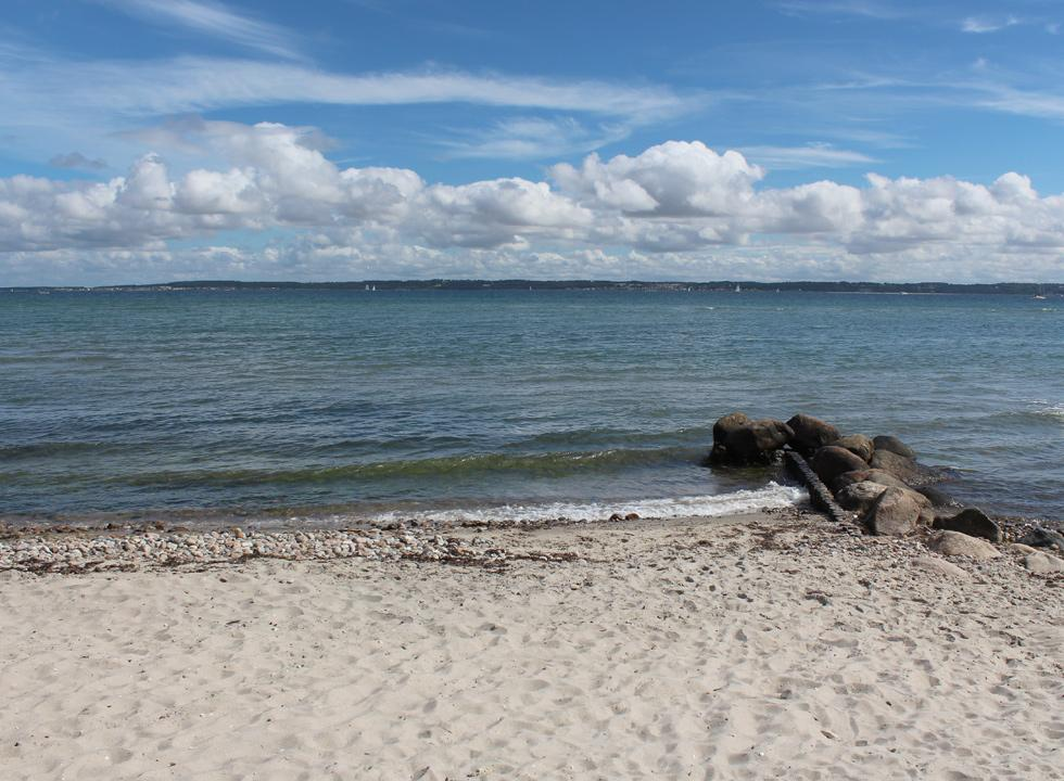 Lovely bathing water by the sandy beach in the holiday home area Hellebæk