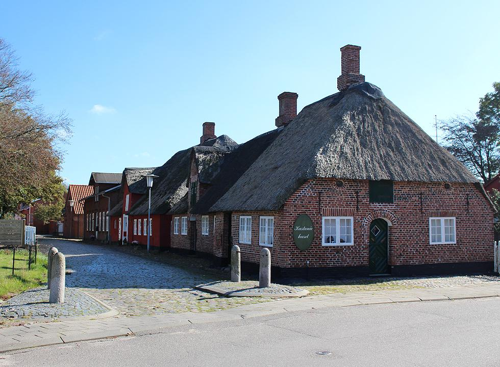 Idyllic town environment with old houses with thatched roofs in Hojer
