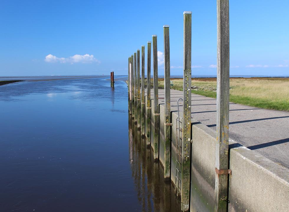 Poles, which indicate the water level of the Danish Wadden Sea by the lock in Hojer