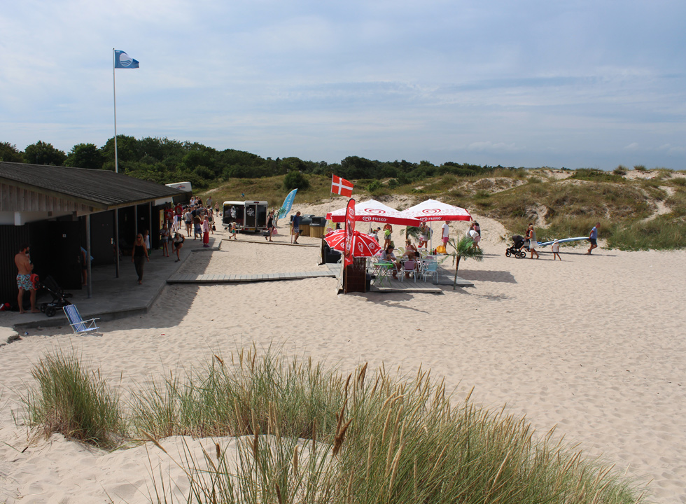 Ice-cream shop and blue flag by the dunes behind the bathing beach in Hornbæk