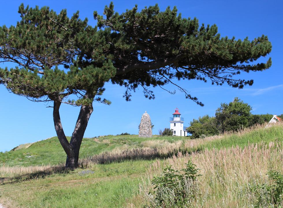 The lighthouse, Spodsbjerg Fyr, and a monumental cairn in honour of the polar explorer Knud Rasmussen