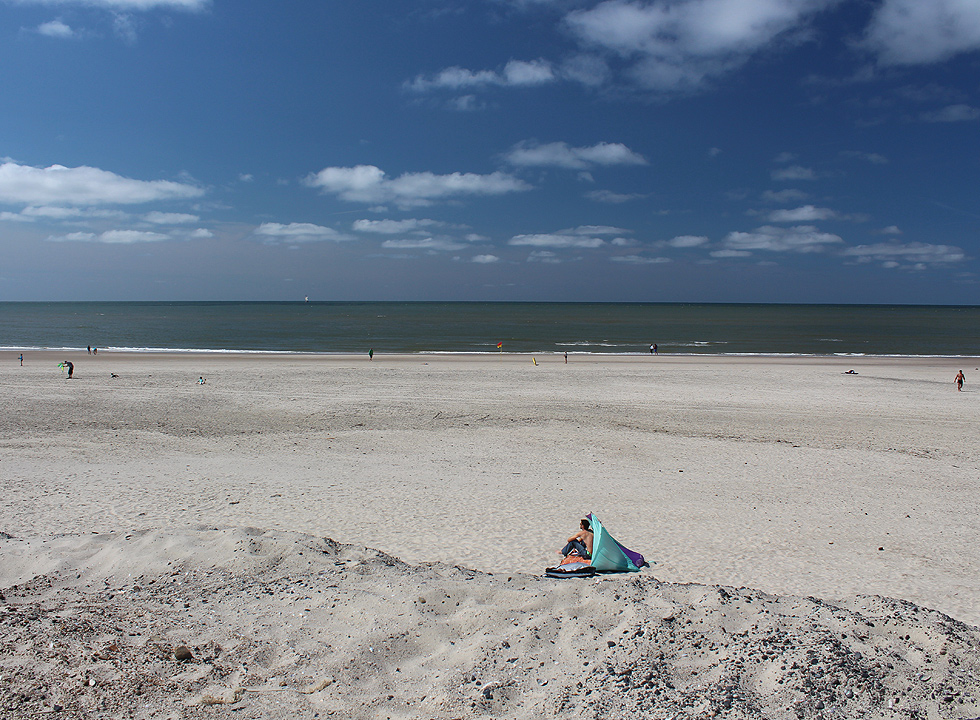 A summer day on the bathing beach in Hvide Sande