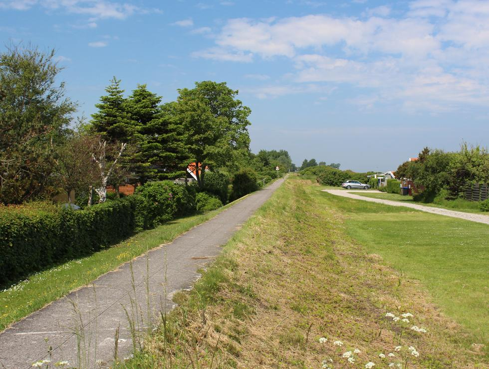 Bicycle path behind the beach and the holiday homes in the holiday area Jørgensø
