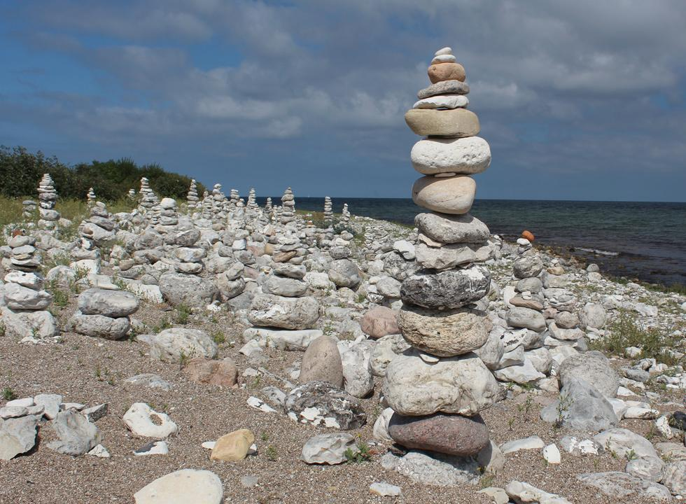 Countless stone towers are characteristic on the shore in Klint
