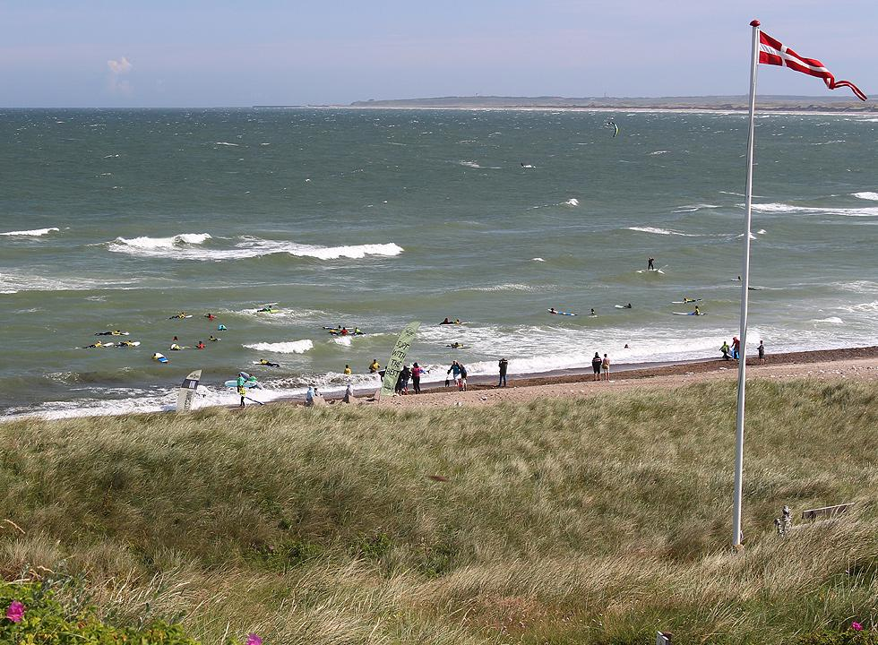 Surfers and spectators on the beach of Klitmoller