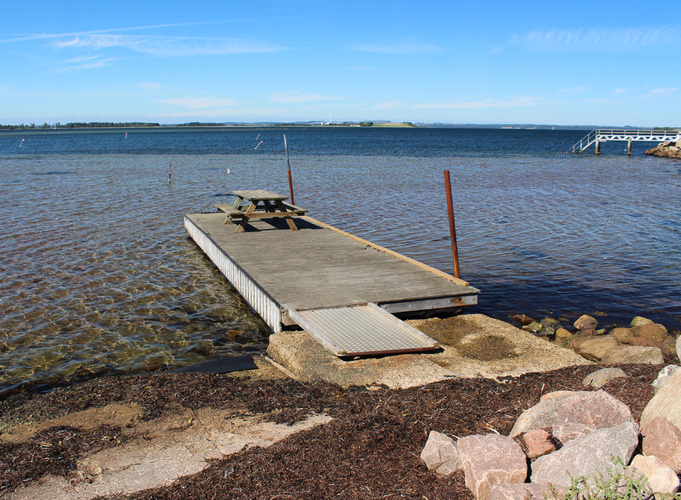 Pontoon with picnic table by the marina in the holiday home area Knebel