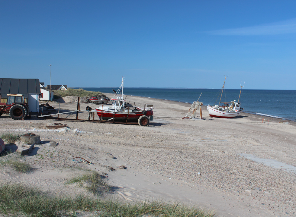 The fishing boats are drawn up on land in the holiday home area Lild Strand