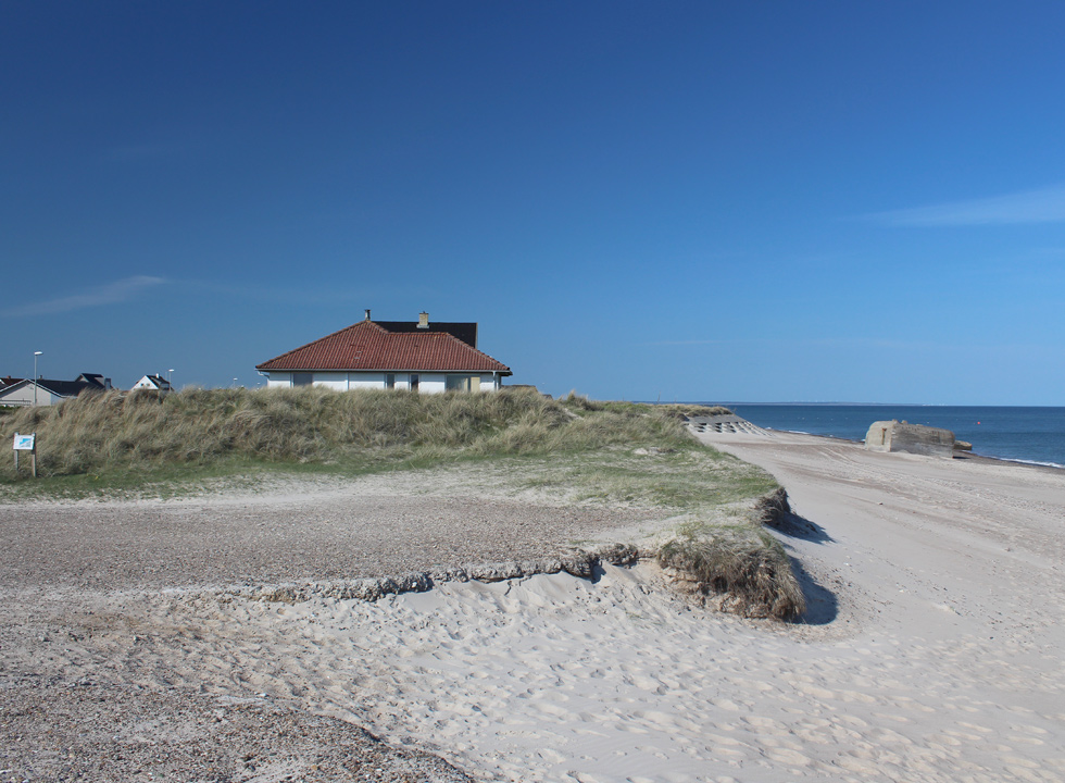 Lovely sandy beach with a bunker below the town and holiday home area Lild Strand