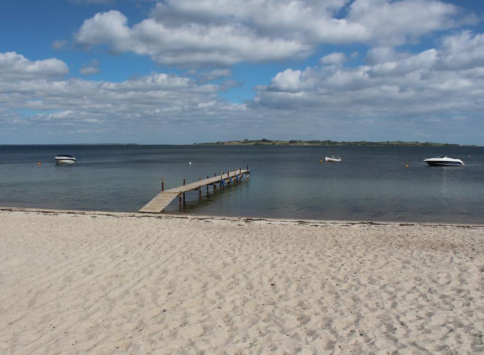 Bathing jetty by the sandy beach in the holiday home area Løjt