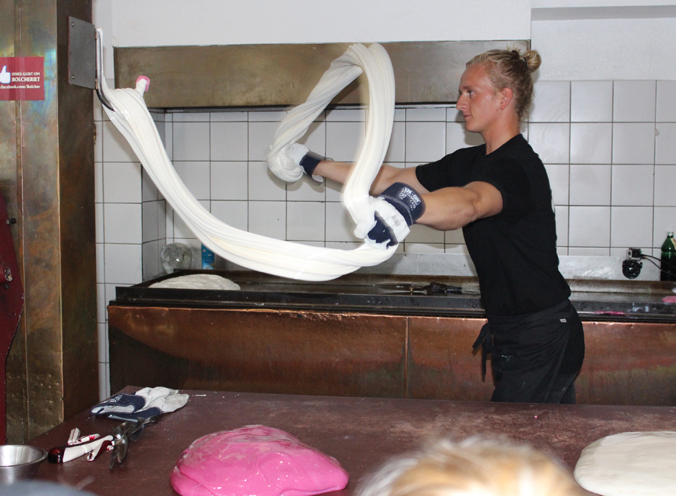 Hard candy maker works with the candy mass in Bolcheriet in Lokken