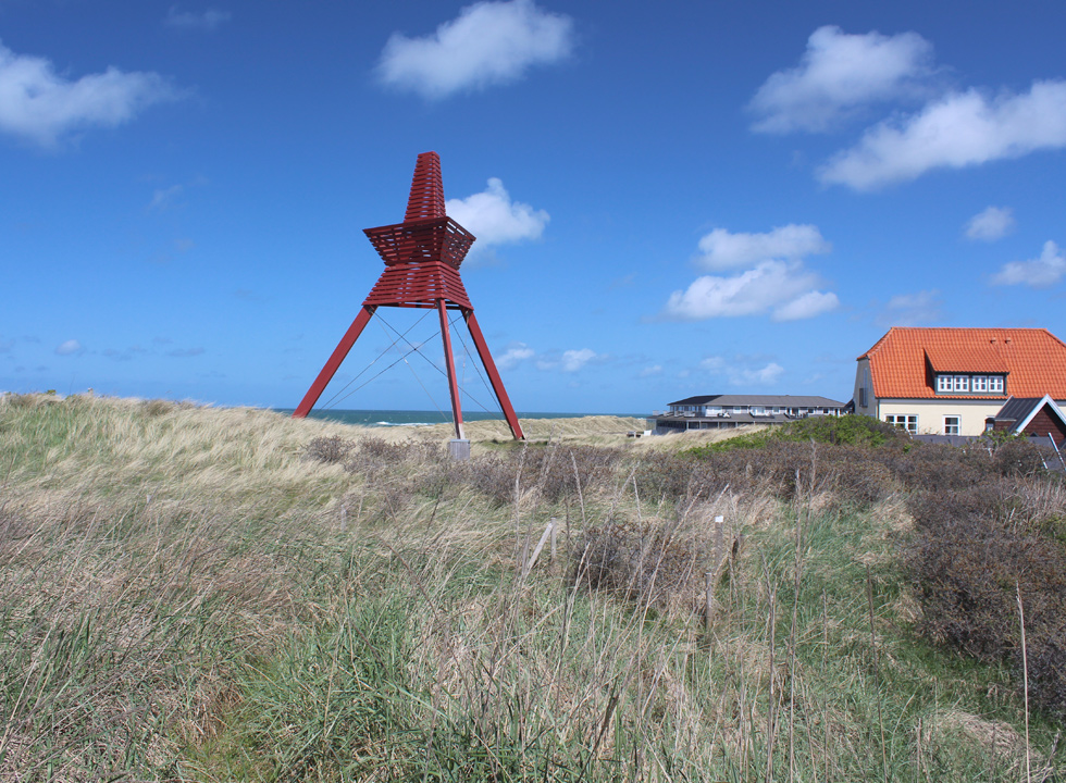 Seamark on top of the dunes in Lokken