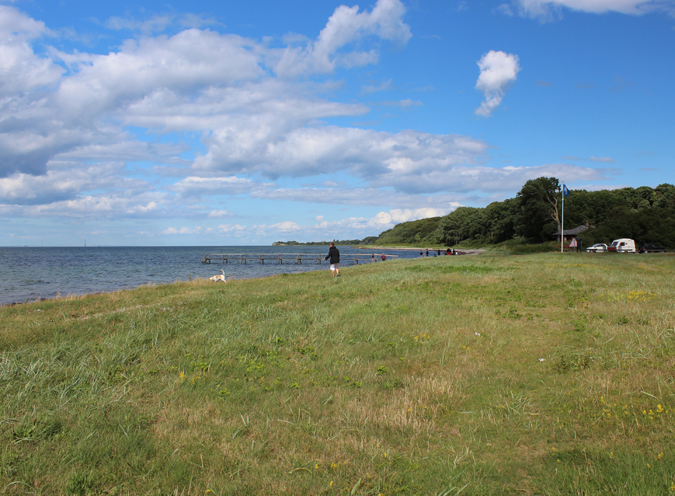 Green spaces surround the bathing beach in Lohals on Langeland