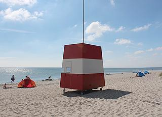 Life guard tower on the popular bathing beach in the holiday home area Marielyst
