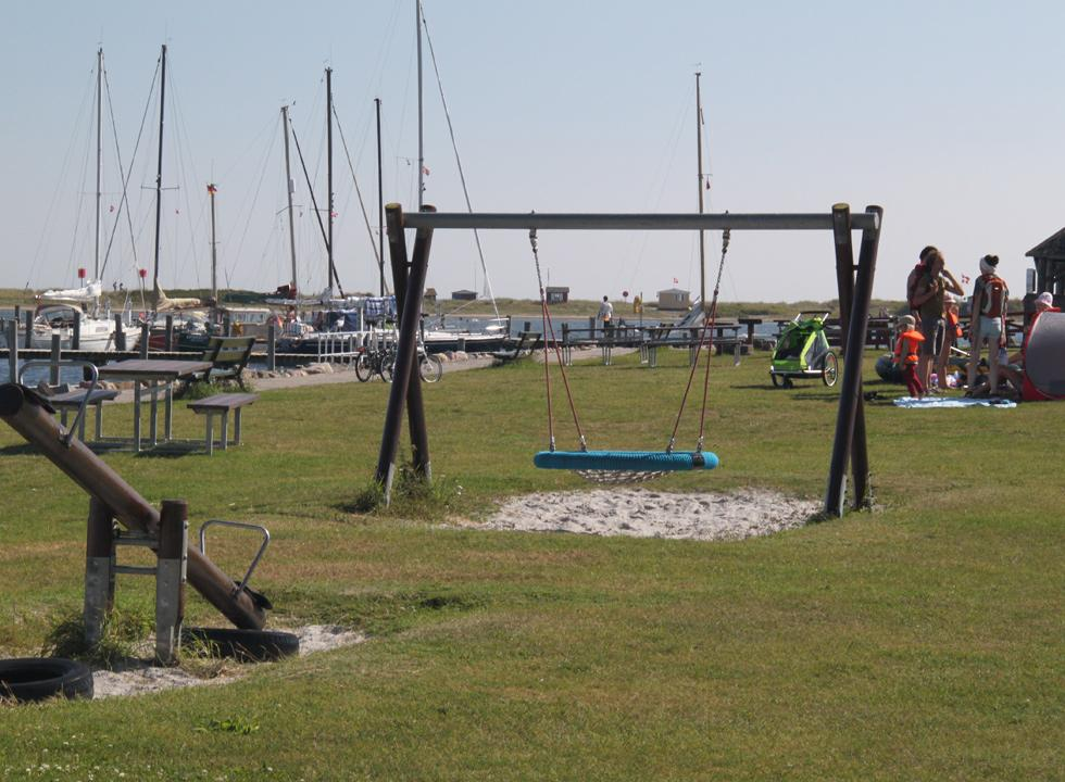 Playground by the marina in Marstal with the bathing houses of Eriks Hale in the background
