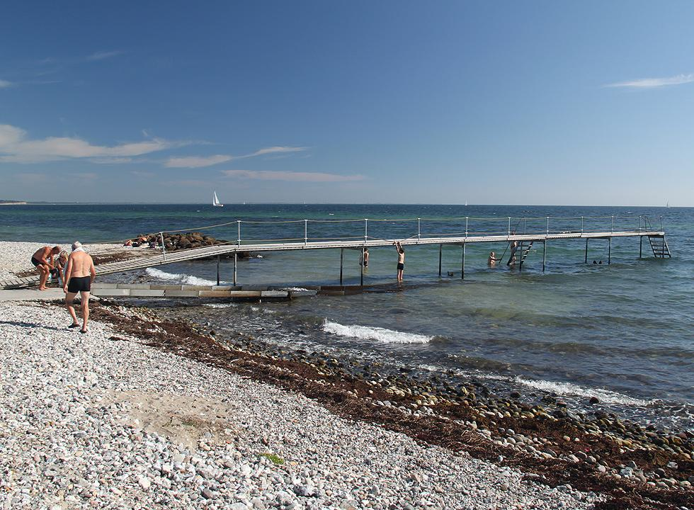 Long bathing jetty by the beach on Eriks Hale in the holiday area Marstal
