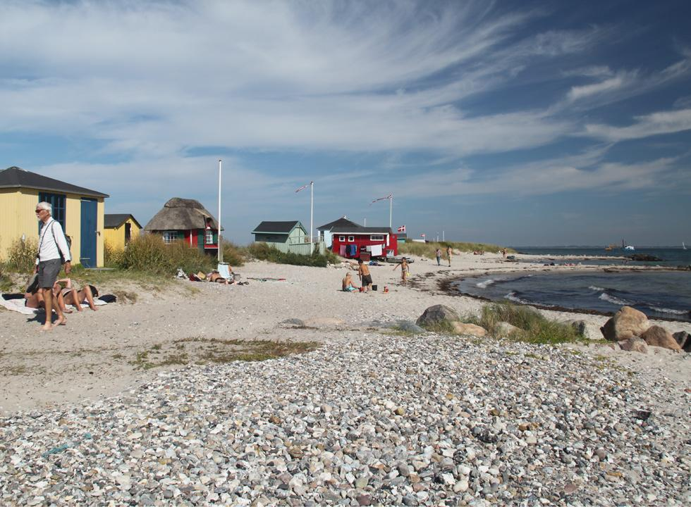 Bathers and cosy beach huts on the tongue, Eriks Hale in Marstal