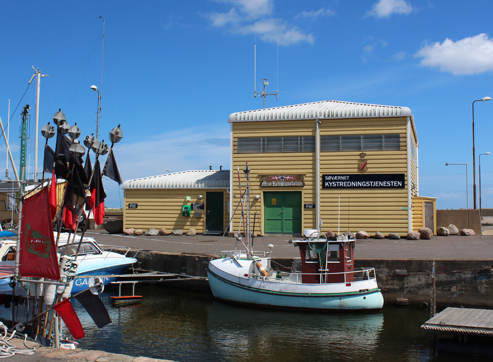 Fishing boat in front of the rescue station in the harbour of Nexø