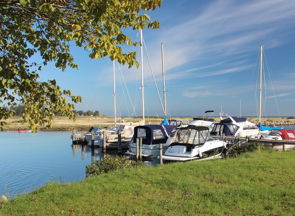 The charming harbour of Norsminde with yachts and leisure boats is located in scenic surroundings