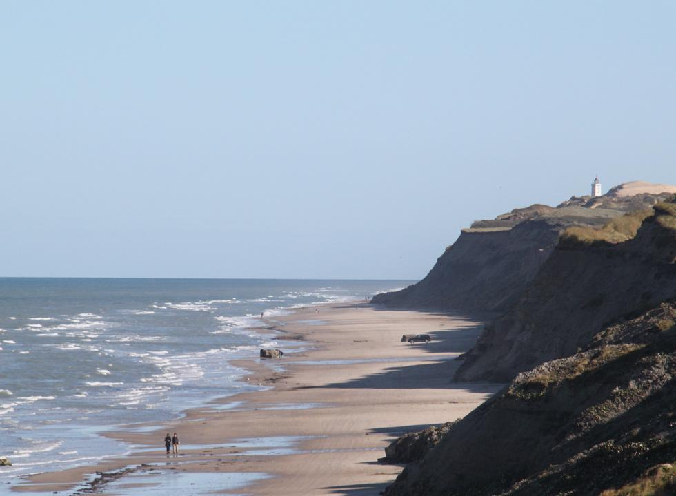 The steep slopes in Nr. Lyngby and the lighthouse Rubjerg Knude Fyr in the background