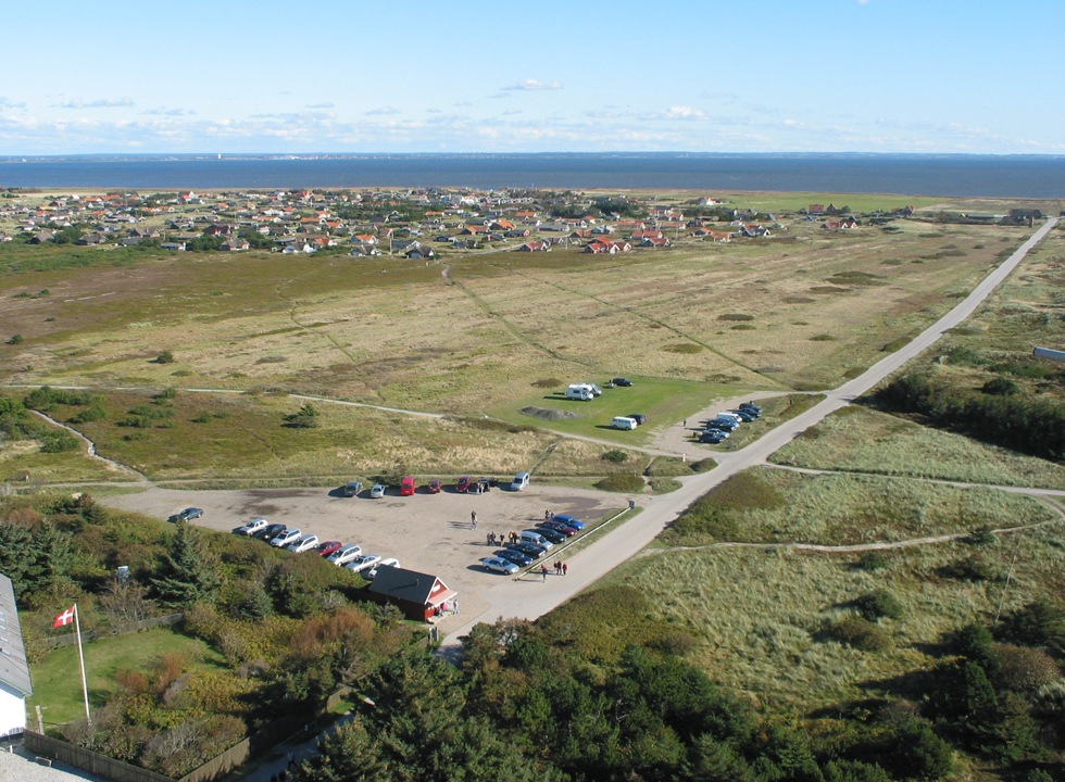 From Lyngvig Fyr you can see the North Sea, the dune landscape, the holiday homes and the bay Ringkøbing Fjord