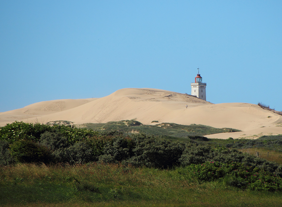 The top of the lighthouse Rubjerg Knude Fyr, surrounded by high sand dunes