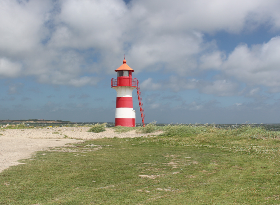 The striped lighthouse on the tongue Odden in the southern part of Oddesund