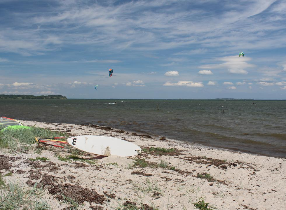Kite surfers on the water by the beach in the holiday area Ørby Hage Strand