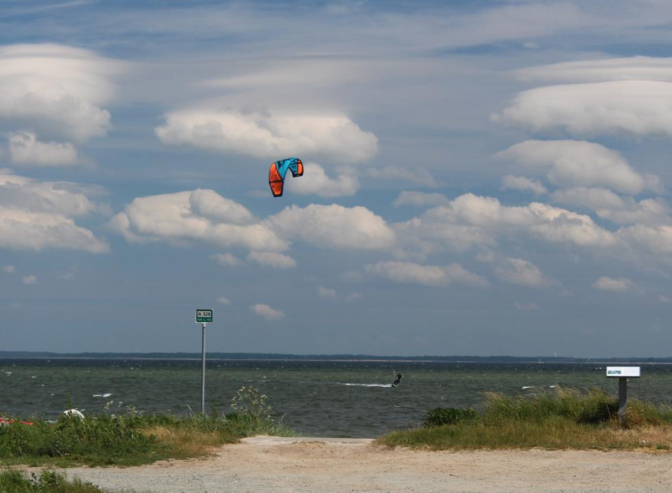 Kite surfer in action opposite the holiday home area Ørby Hage Strand
