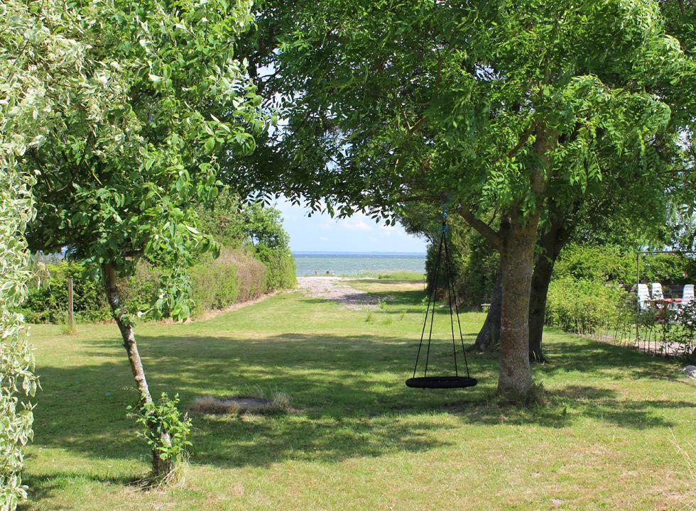 View of the sea between the holiday homes of Ørby Hage Strand
