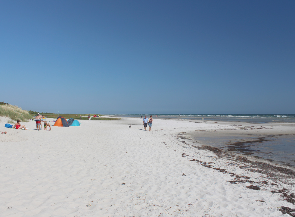 The lovely sandy beach in Oster Hurup invites relaxation, walks and swimming