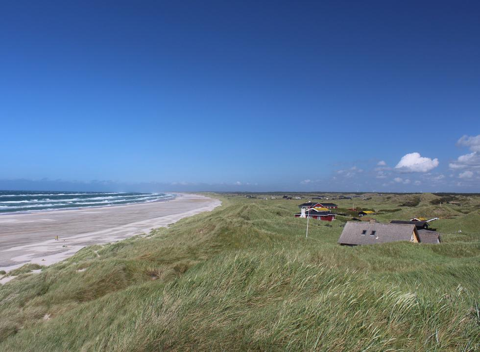 Holiday homes in the dunes behind the wide sandy beach of Rødhus