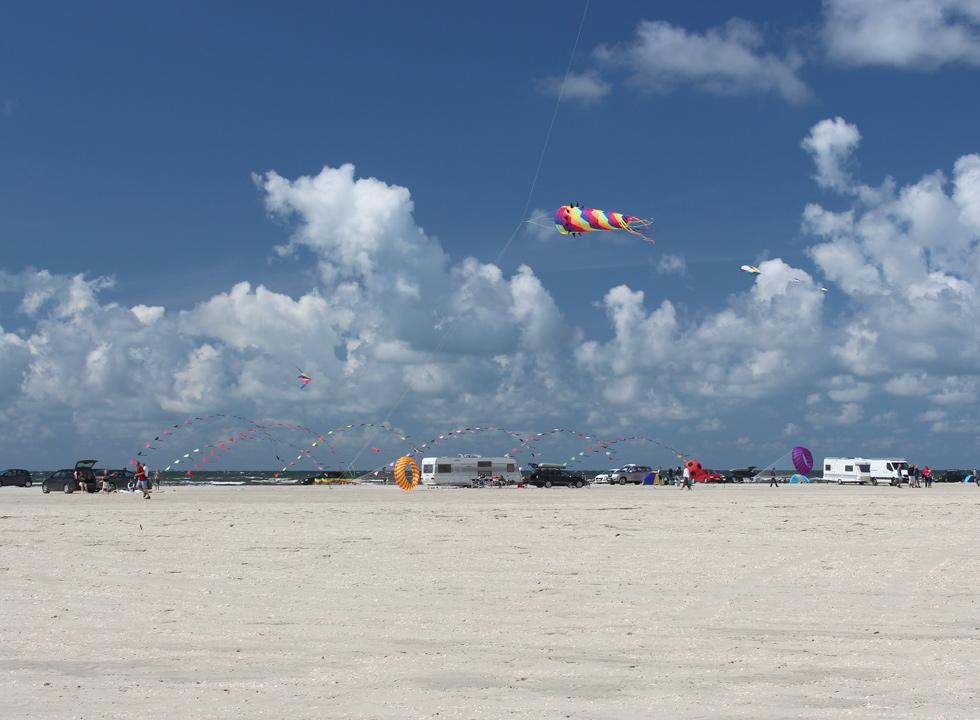 Enjoy the sight of the many kites on the sky over the beach Lakolk Strand, 12 km from Havneby