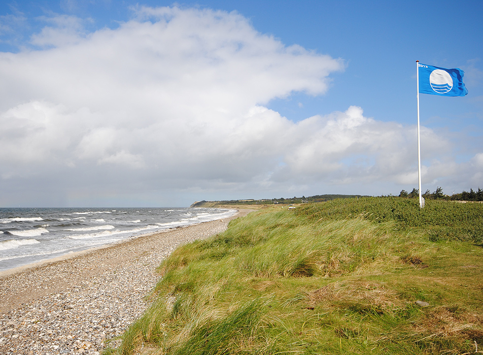 Beautiful landscapes and blue flag by the bathing beach in Rønbjerg