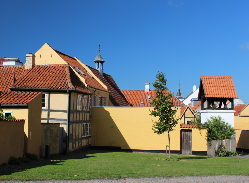 Cosy environment with old half-timbered houses and a belfry in Rudkøbing
