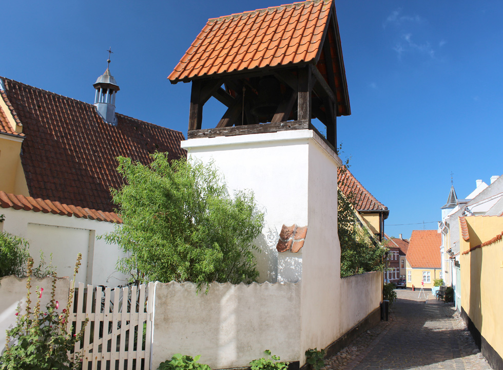 Charming alley by the belfry in the centre of Rudkøbing