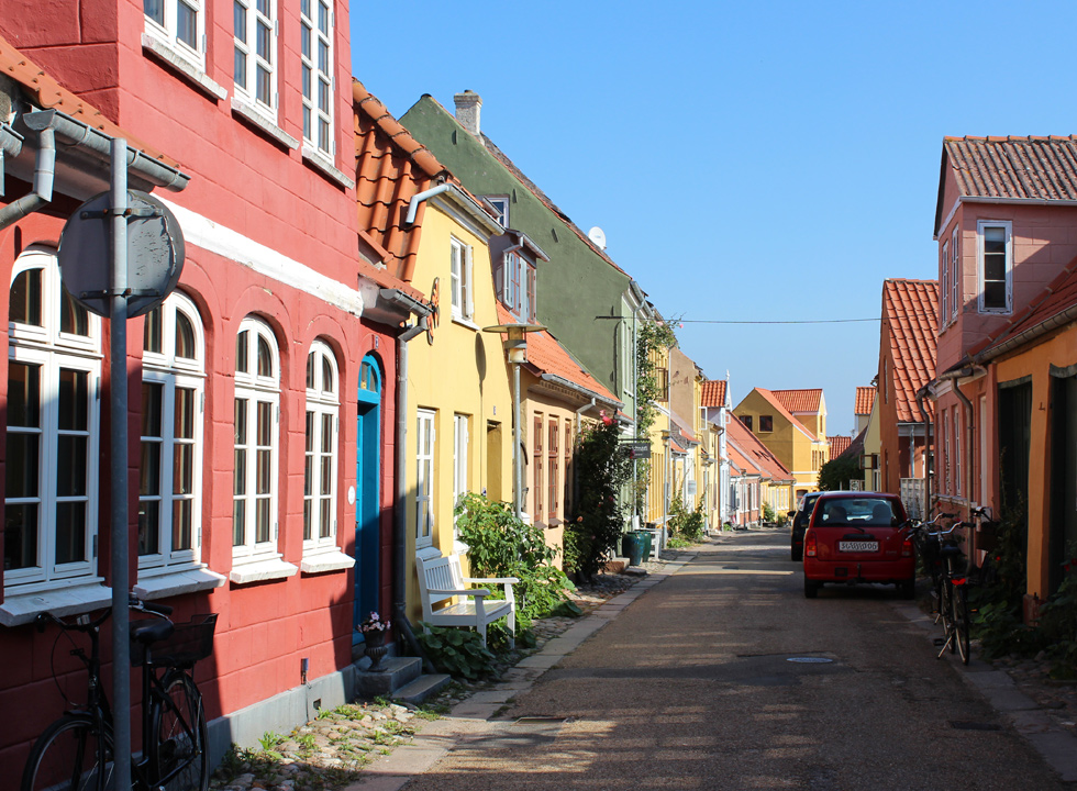 Idyllic street with well-maintained houses in many colours in the centre of Rudkøbing