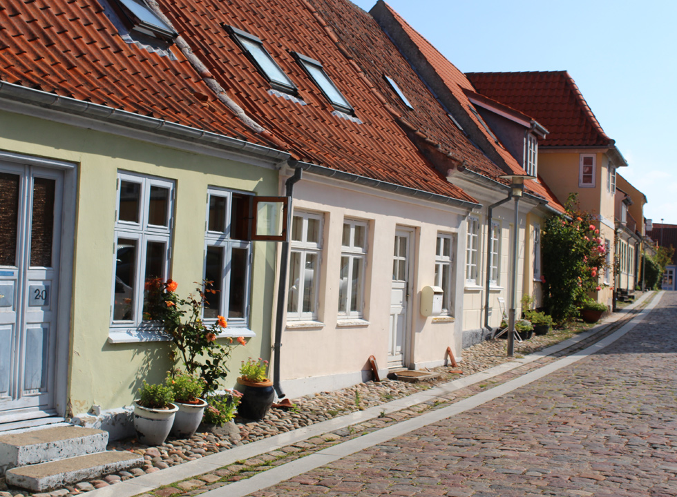 Cobbled street with charming old houses in Rudkøbing