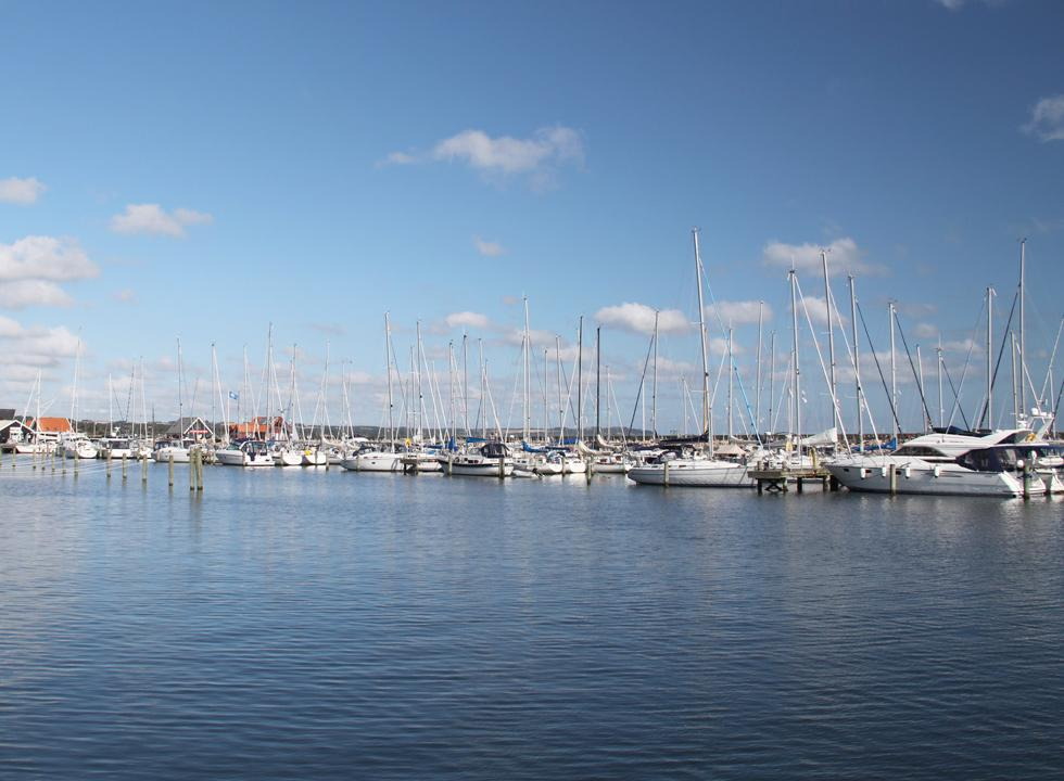 Charming and vivid atmosphere in the marina with eateries and shops in Sæby