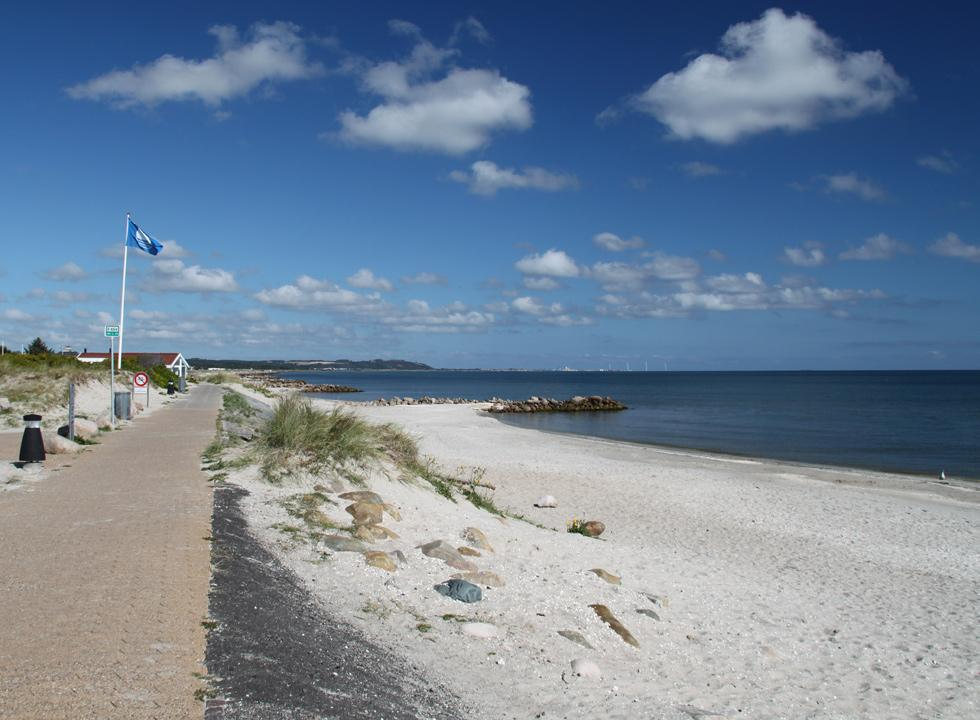 The lovely sandy beach with shallow child-friendly water and breakwaters in Sæby