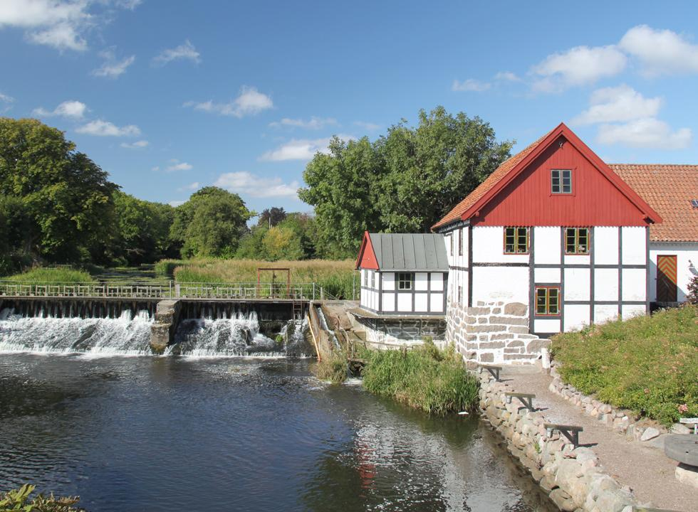Idyllic half-timbered watermill from the year 1710 by the stream Sæby Å